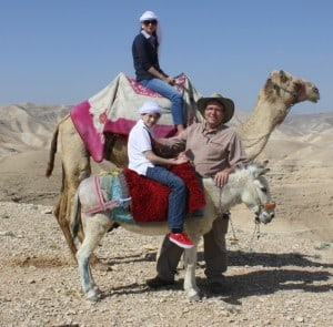 family on a camel and donkey Judean Desert
